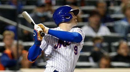 Brandon Nimmo #9 of the Mets follows through