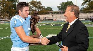 QB Charlie McKee shakes hands with Newsdays Gregg