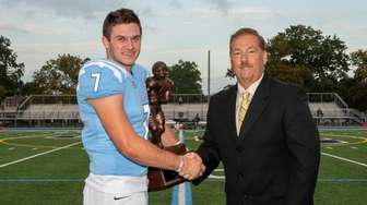 QB Charlie McKee holding trophy with Newsday Greg