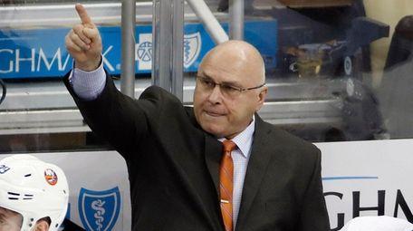 Islanders head coach Barry Trotz stands behind his