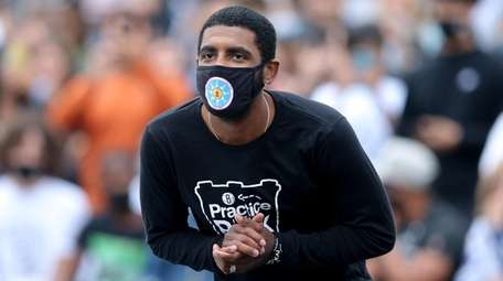 Nets guard Kyrie Irving practices with the team