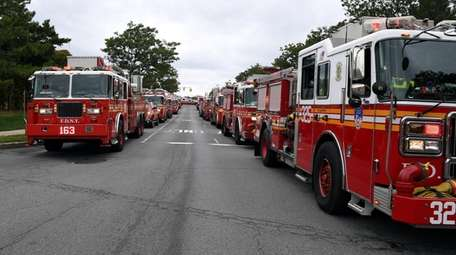 FDNY firetrucks on standby as a plane lands