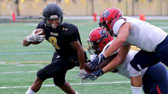 St. Anthony's RB Joshua Escobar tries to get