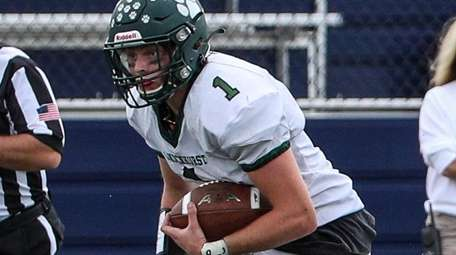 Lindenhurst's Chris Carson looks for an opening during