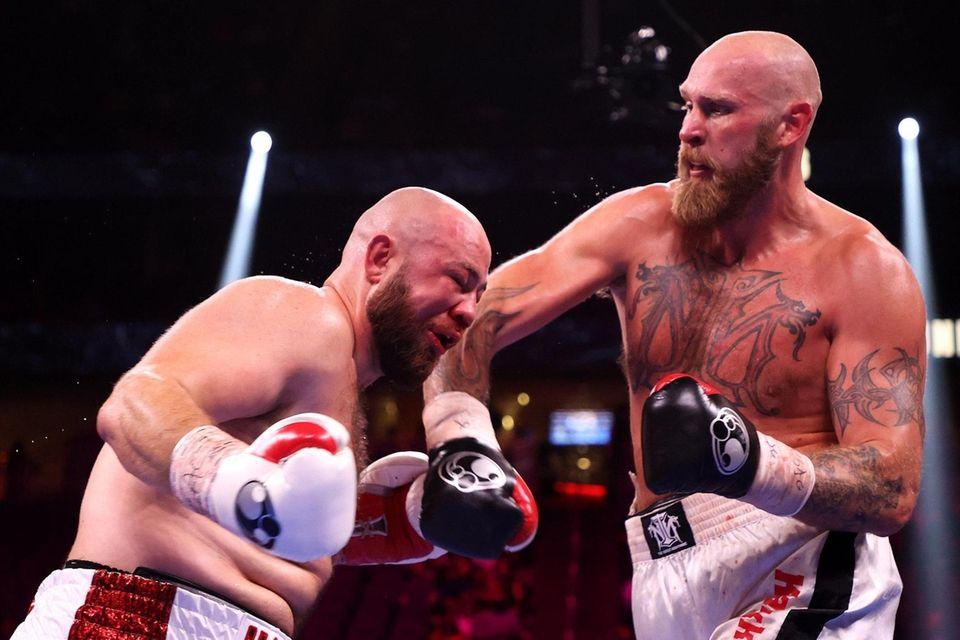Robert Helenius (R) punches Adam Kownacki during their
