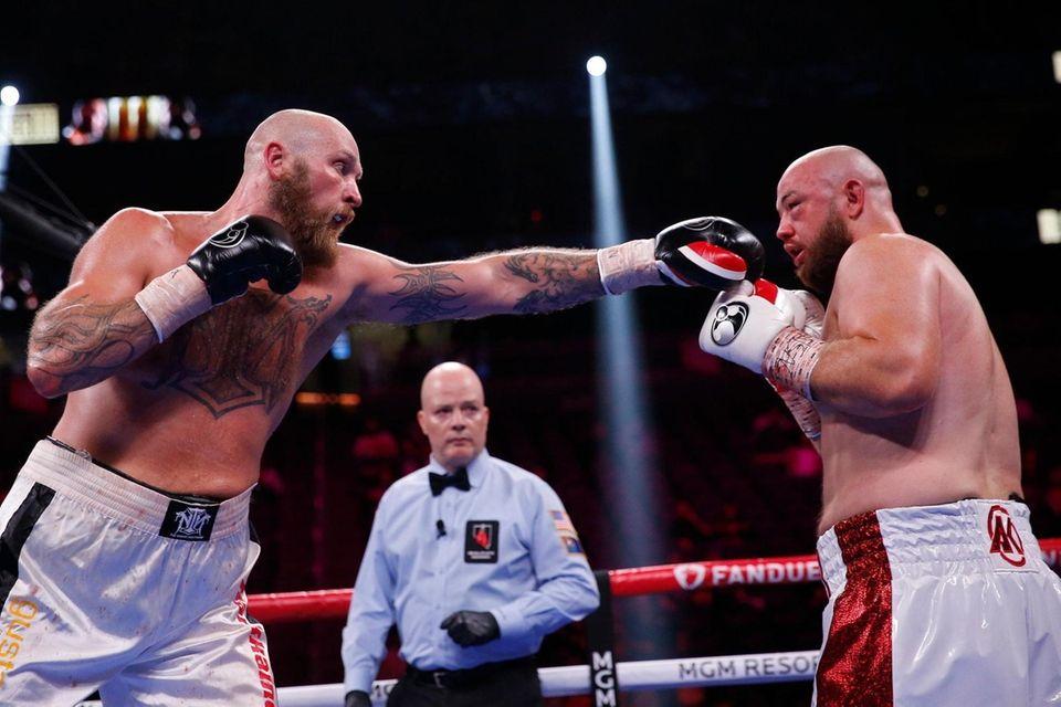 Robert Helenius, left, of Finland, fights Adam Kownacki,