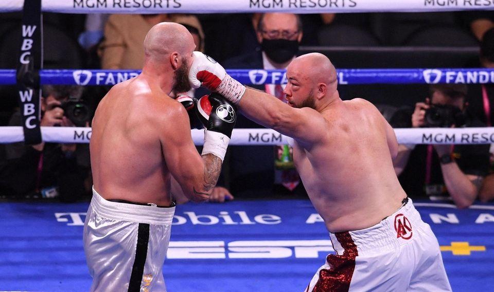 "Poland's Adam ""Babyface"" Kownacki (R) lands a punch"