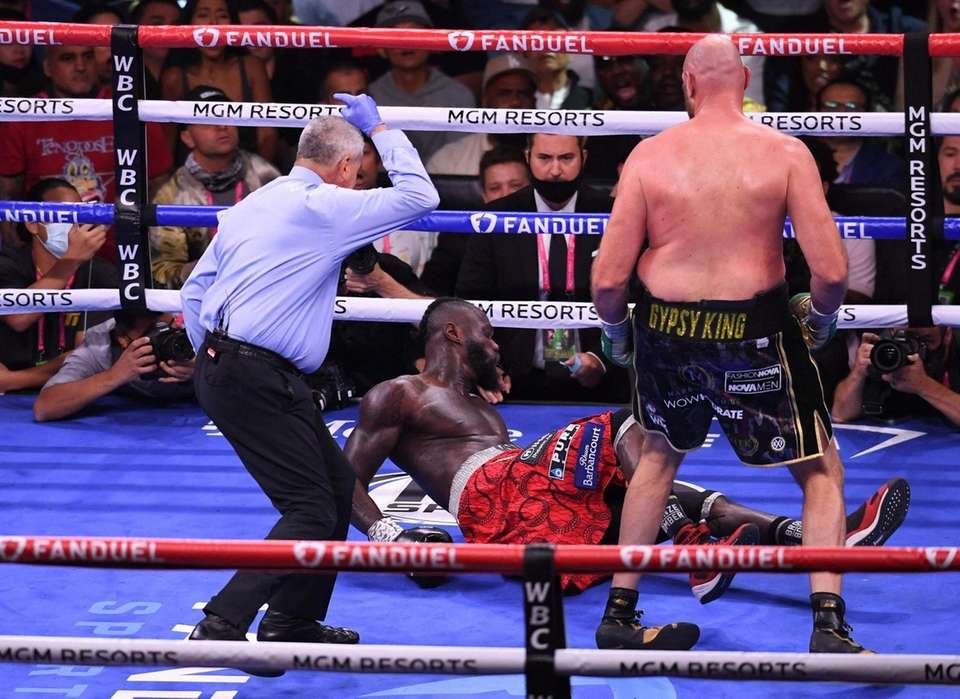 US challenger Deontay Wilder is knocked down by