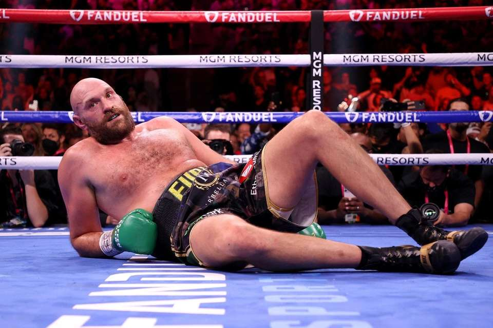 Tyson Fury reacts after a knock down by