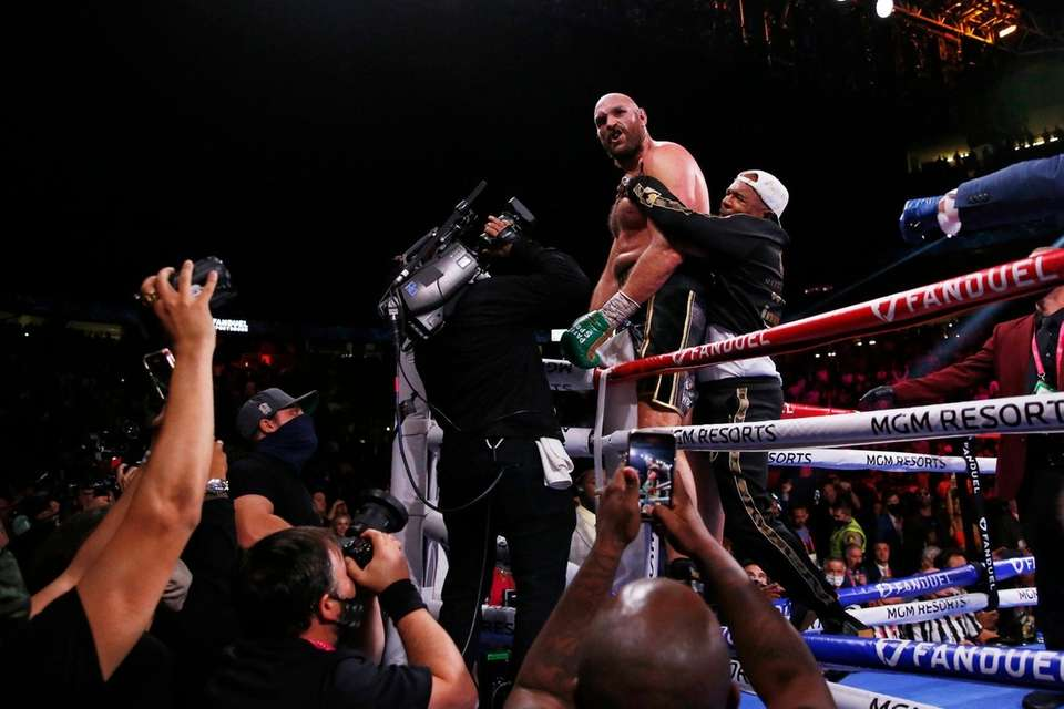 Tyson Fury, of England, celebrates after defeating Deontay