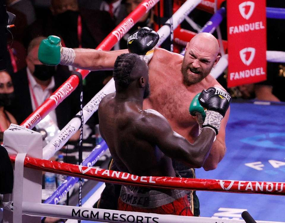 Tyson Fury (top) knocks out Deontay Wilder in