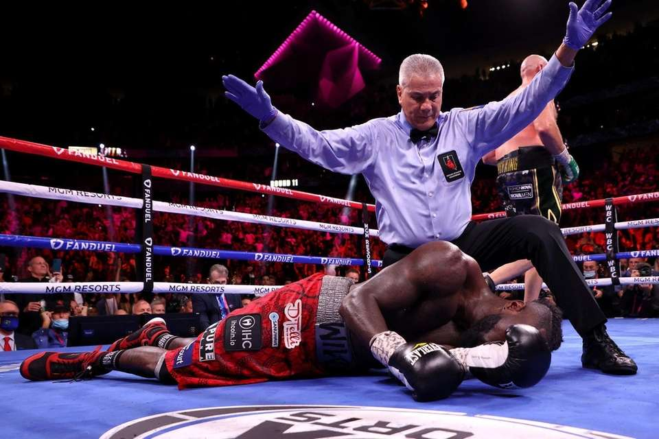 Referee Russell Mora calls the fight after Tyson