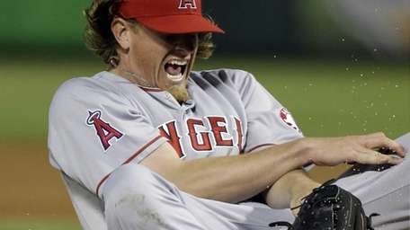 Los Angeles Angels starting pitcher Jered Weaver reacts