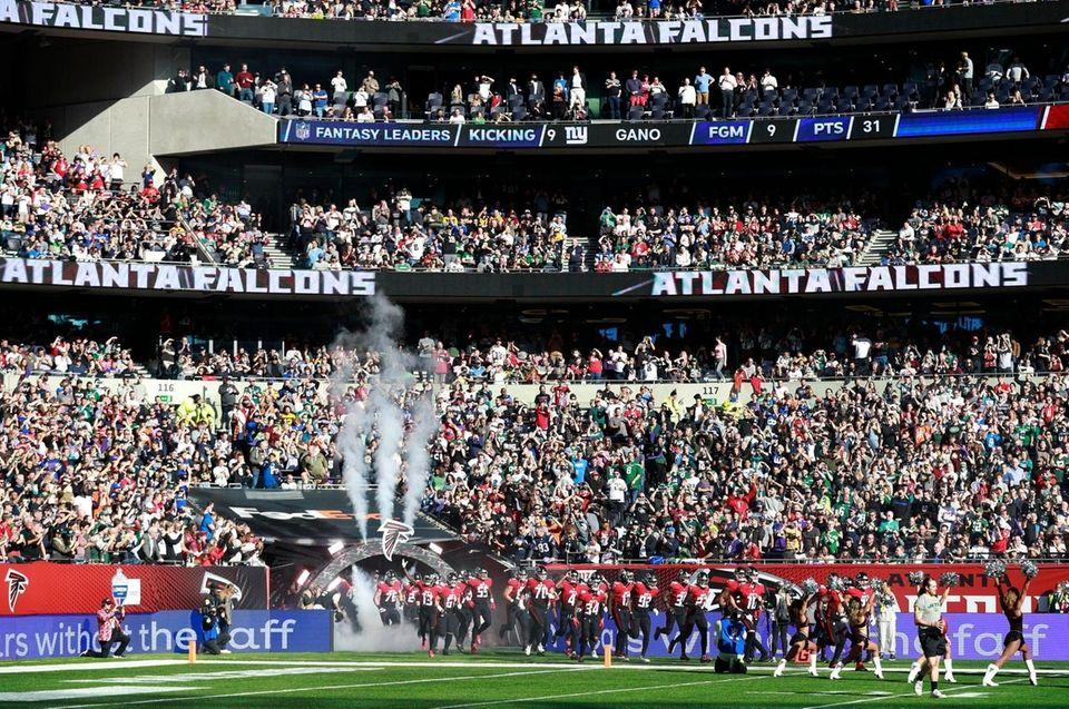 The Atlanta Falcons run onto the field for