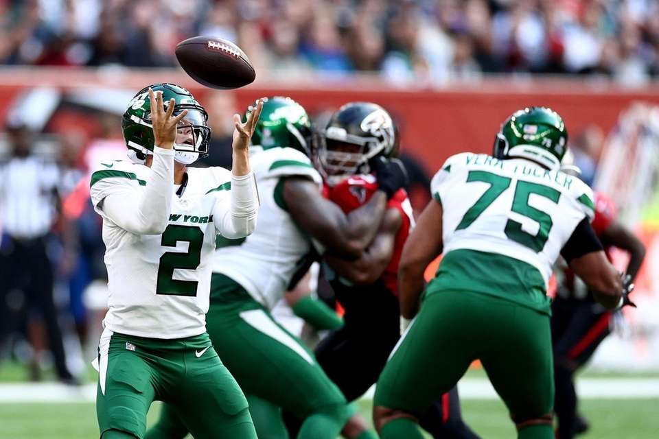 Zach Wilson of the Jets fumbles the ball