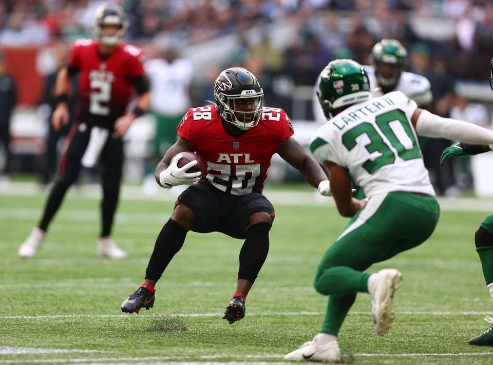Mike Davis #28 of the Atlanta Falcons carries