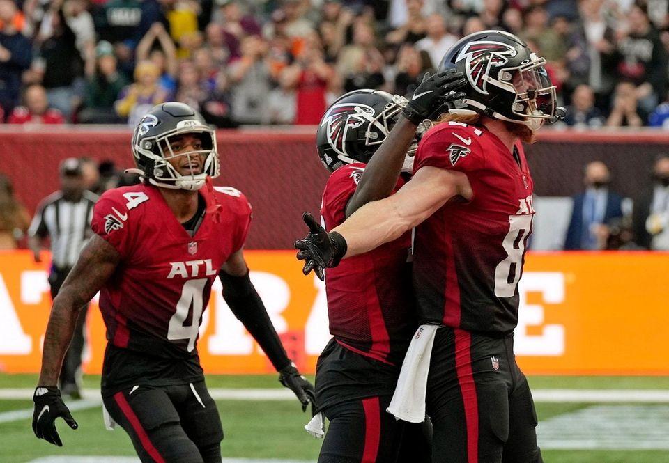 Atlanta Falcons tight end Hayden Hurst (81), right,