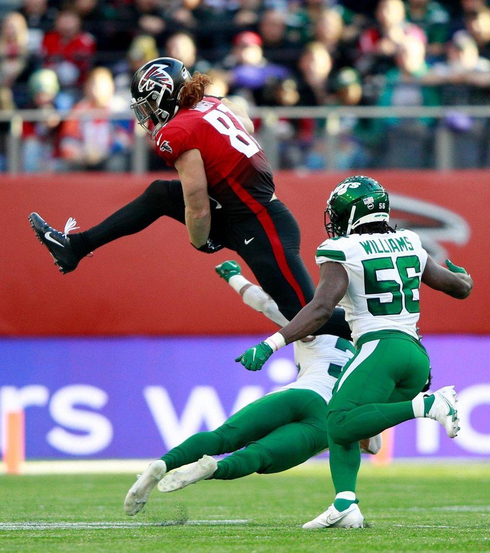 Atlanta Falcons tight end Hayden Hurst (81) leaps