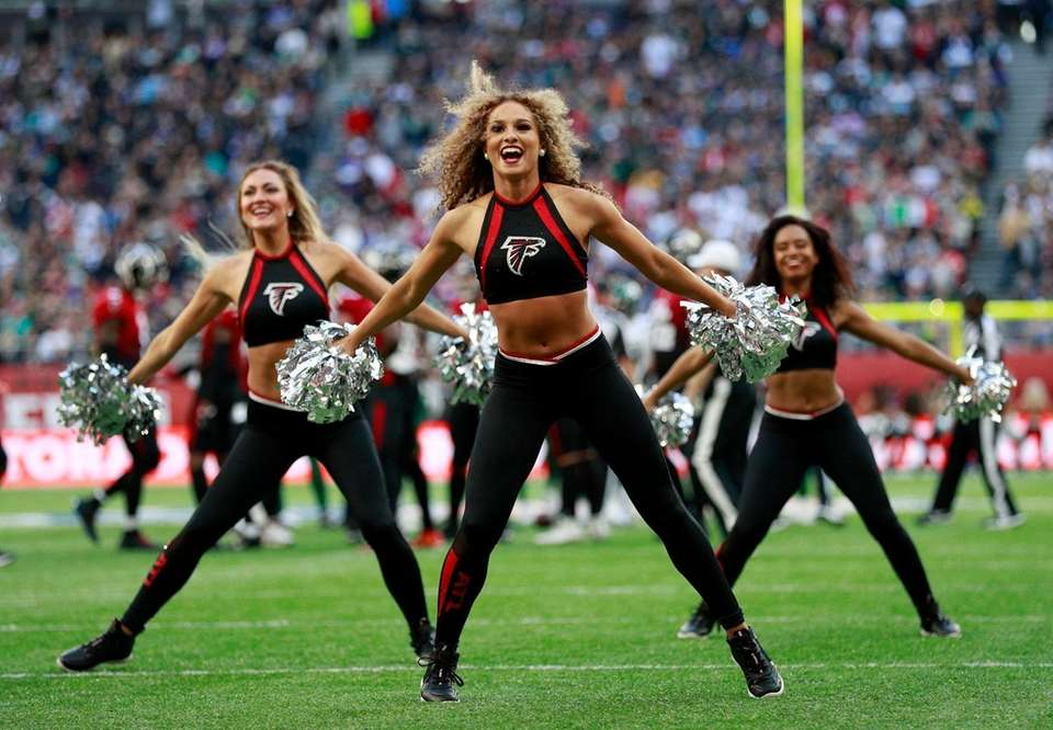 Falcons cheerleaders perform on the field before an