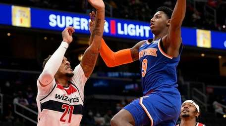 Knicks guard RJ Barrett goes to the basket