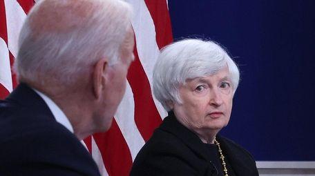 Treasury Secretary Janet Yellen listens to President Joe