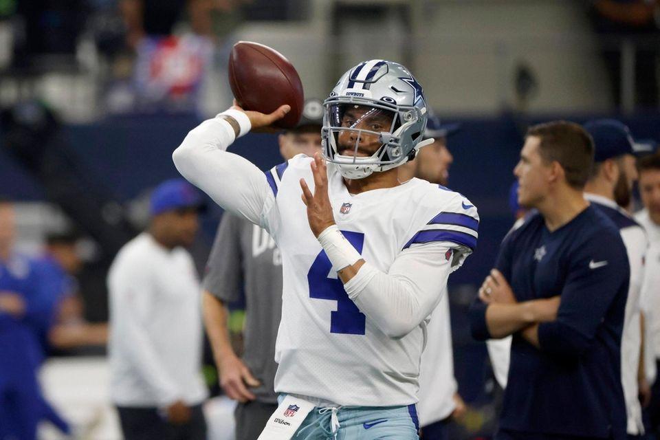 Dallas Cowboys quarterback Dak Prescott warms up before