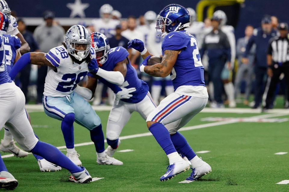Dallas Cowboys safety Malik Hooker (28) defends as