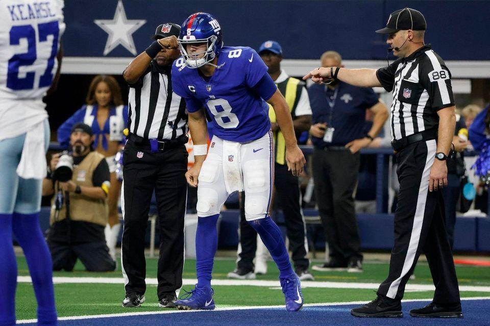 Giants quarterback Daniel Jones attempts to walk off