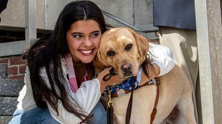 Garden City's Anastasia Pagonis hugs her dog Radar