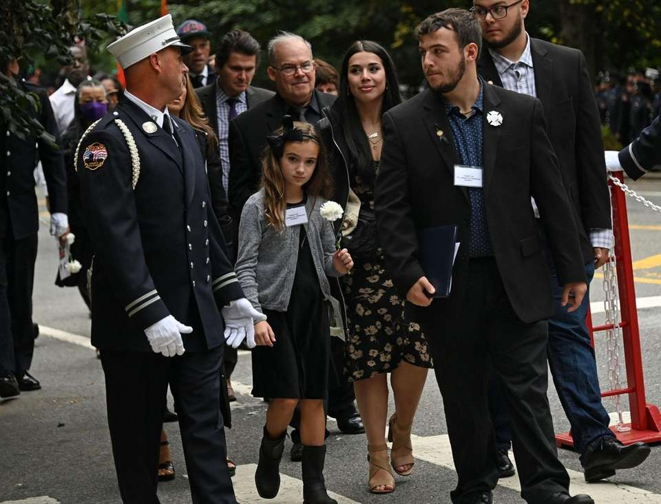 The Ferrugia family walks together while honoring Firefighter