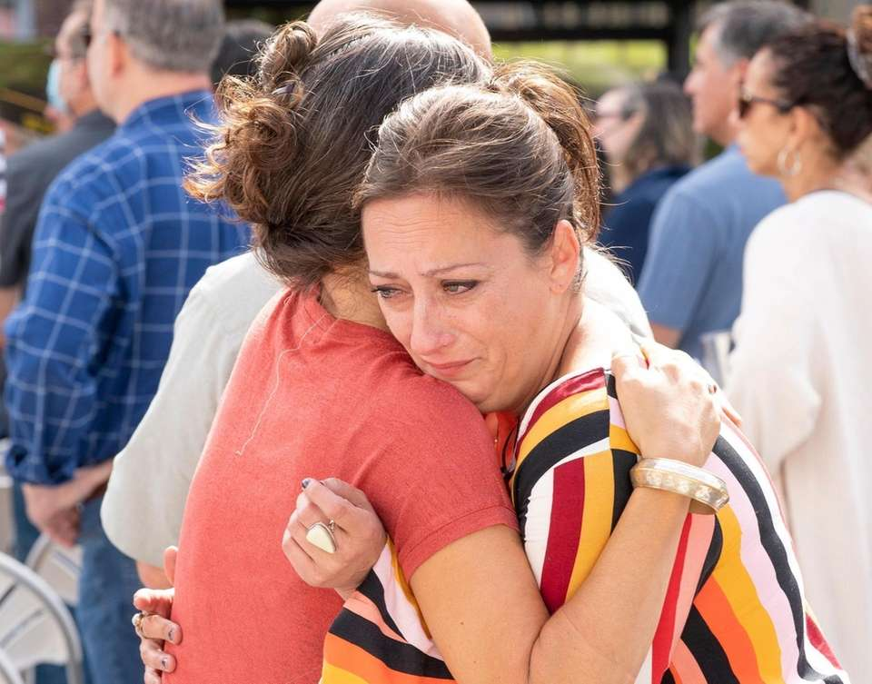 Mary bakel, right, of Baltimore, hugs her sister