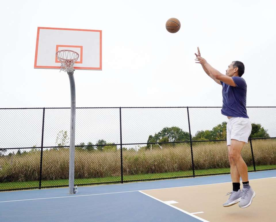Chen Zhou, of Plainview, enjoys time outside at
