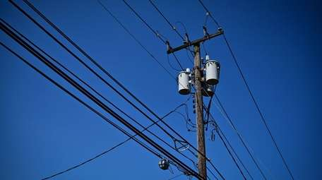 Power lines on utility poles in Smithtown are