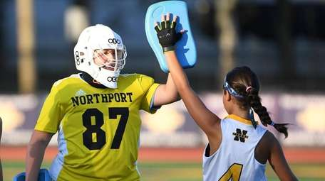 Northport goalkeeper Kailey Maloney high fives with Elizabeth