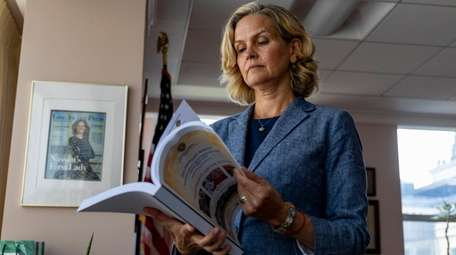 Nassau County Executive Laura Curran looks over the