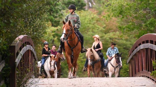 Danae Oliveri, 17, of West Islip, rides alongside