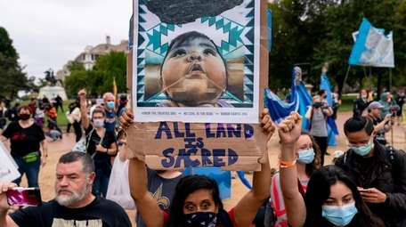 Indigenous and environmental activists protest in front of