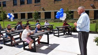 Principal James Moeller addresses a sixth-grade social-studies class