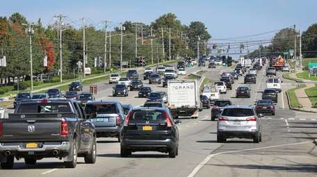 Traffic moves along a section of Route 347