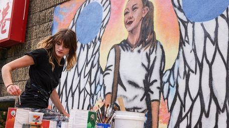 Tess Parker, an artist from East Islip, paints