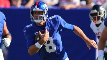 Daniel Jones #8 of the Giants runs with