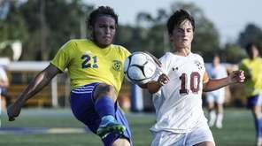 Lawrence's Franklin Arriega keeps the ball away from