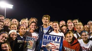 The Oceanside and Syosset soccer teams surround Oceanside