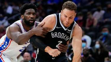 Nets' Blake Griffin, right, is grabbed by Philadelphia
