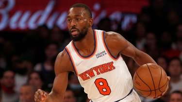 Kemba Walker #8 of the Knicks controls the