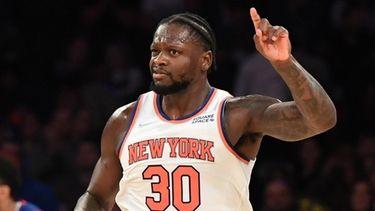 New York Knicks forward Julius Randle gestures after