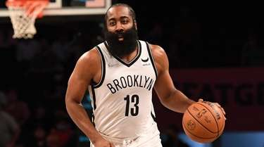 Nets guard James Harden controls the ball against