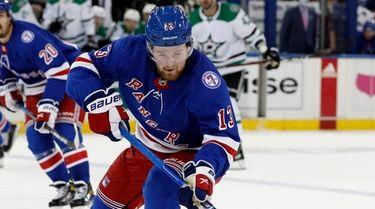 Alexis Lafreniere #13 of the Rangers skates against