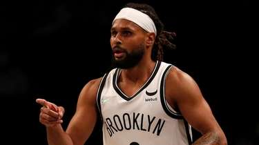 Patty Mills #8 of the Nets reacts after