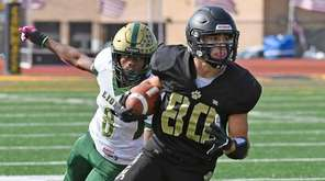 Commack's Domenic Pirraglia outruns Longwood's Tyson Taylor for